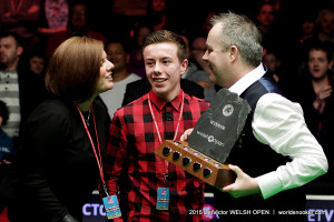 Higgins celebrates the title with wife Denise and son Pierce