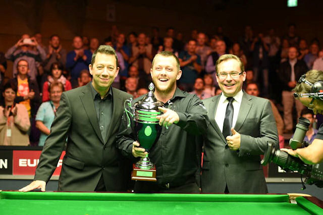 On the Mark: Allen celebrates with the trophy