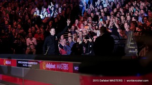 Shaun Murphy walks through the crowds to the table