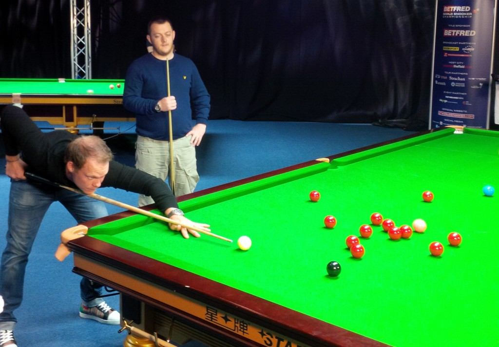 Willett takes on Mark Allen on a  practice table at the Crucible