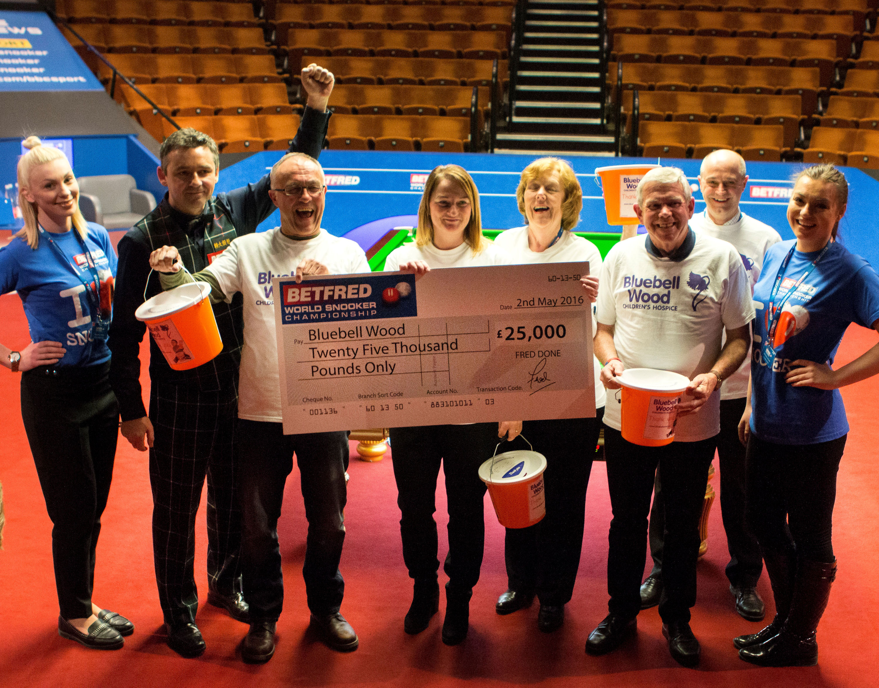 Alan McManus presents a cheque from Betfred to Bluebell Wood volunteers