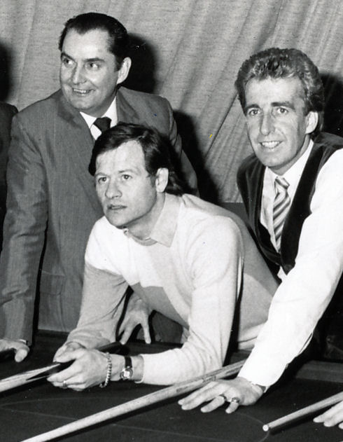 Alex Higgins, flanked by Ray Readon and Terry Griffiths